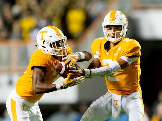 Tennessee quarterback Jarrett Guarantano (2) hands the ball to Tennessee running back Ty Chandler (3) during an game between Tennessee and Southern Miss at Neyland Stadium in Knoxville, Tennessee, on Saturday, Nov. 4, 2017.