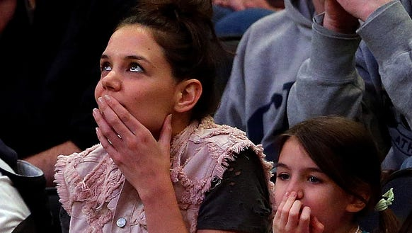Katie Holmes and her daughter Suri Cruise attend the