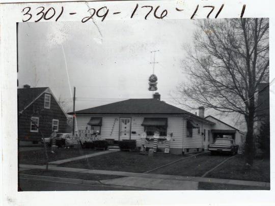 This house, on Loraine Street in Lansing, was the home of an LPD motorcycle officer who was well-known for building his own holiday yard décor. The photo is one of nearly 17,000 images available in CADL's Local History Online City of Lansing Assessor Photographs Collection