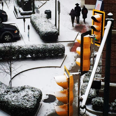 Commuters find a path along  snowy sidewalk at Chambersburg