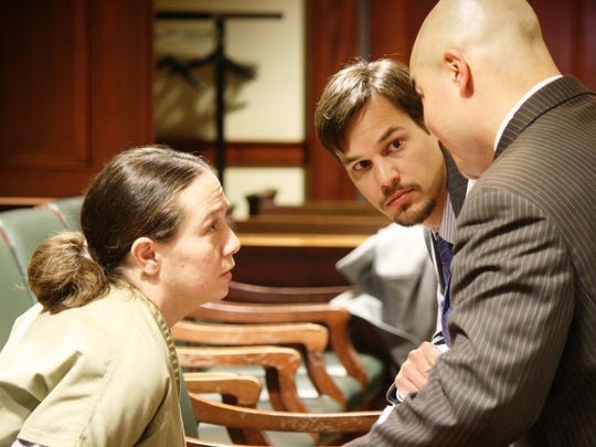 April Corcoran, left, speaks with court-appointed attorneys