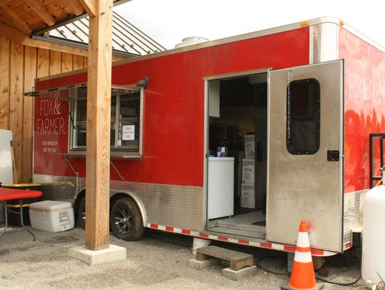 A food truck operated by Fox & Farmer Inc. is located