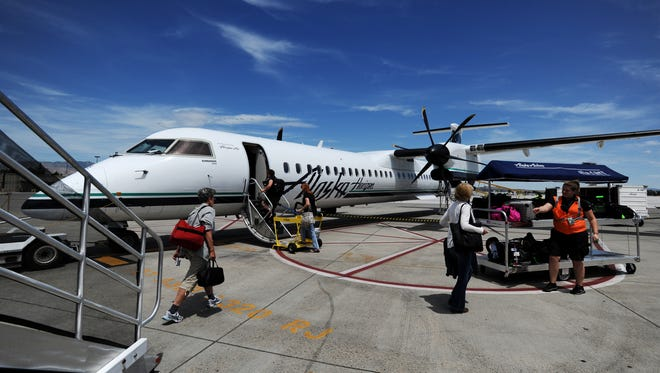 An Alaska Airlines plane gets loaded with passengers on the tarmac at the Reno-Tahoe International Airport in Reno on Tuesday, June 30, 2015.