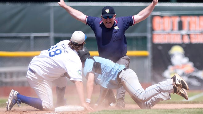 The umpire rules South Burlington's Nolan Antonicci, right, safe at third base during the Division I high school baseball state championship game at Centennial Field in June.