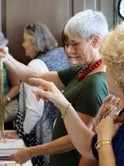 AAUW's Time, Talent, & Treasure event boasts 161 silent auction items.