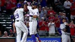 Rougned Odor celebrates his two-run homer with with
