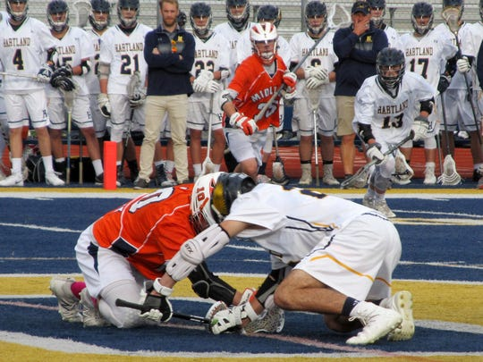 Faceoff specialist Jake DeYoung (right) is one of three Hartland lacrosse players on the All-State first team.
