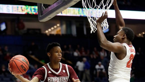Mississippi State guard Tyson Carter (23) passes around
