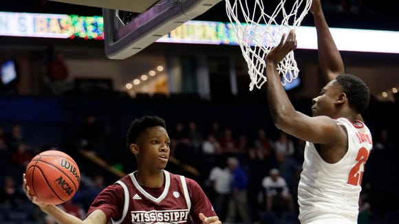 Mississippi State guard Tyson Carter (23) passes around Alabama guard Brandon Austin, right, during the second half of an NCAA college basketball game at the Southeastern Conference tournament Thursday, March 9, 2017, in Nashville, Tenn. Alabama won 75-55.
