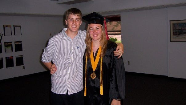 Flashback: Jen Zettel shares a moment with her younger brother on her graduation day in June 2007.