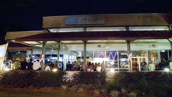 Proposed trolley service from the city?s StarMetro could move people around Midtown, pictured here, Cascades Park and Gaines Street. Democrat files The Midtown Filling Station, located in the Manor at Midtown in Tallahassee, Fla, is filled with people during the early morning hours of October 27, 2012. Michael Schwarz