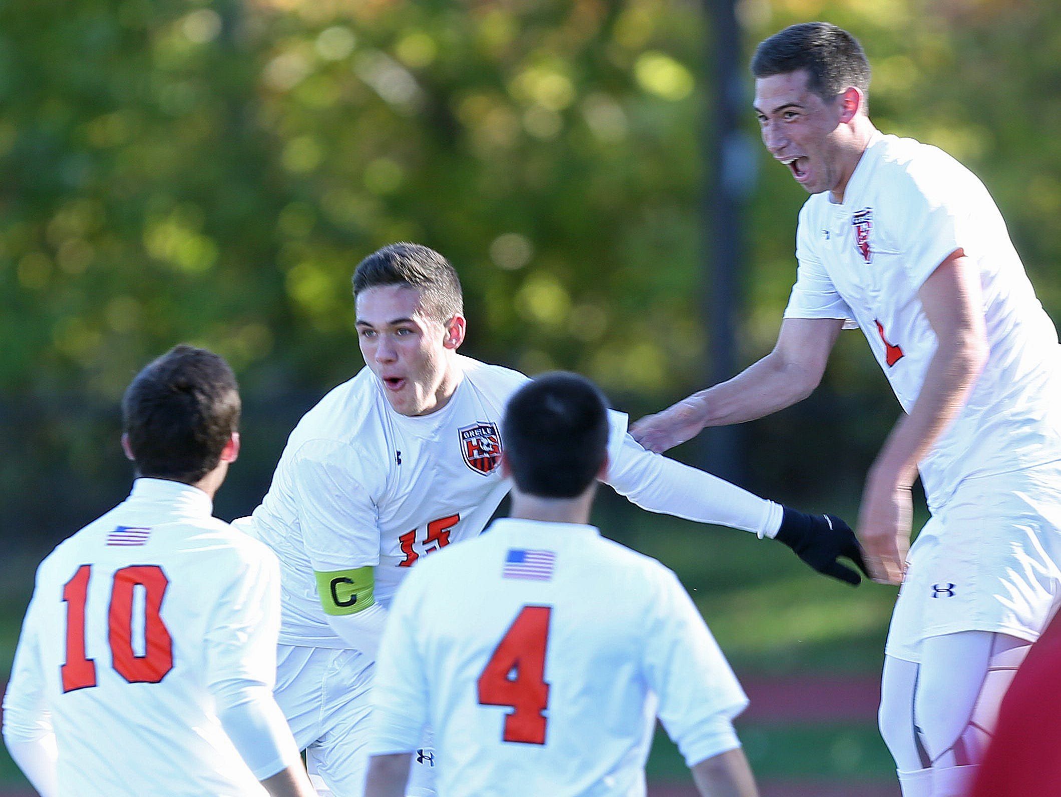 Greeley's Matt Neuberger (15) celebrates his first of three first half goals with teammates Danny Cannon (10), Jack Cohen (4) and Greg Ginsberg (11) during a boys soccer playoff game against North Rockland at Horace Greeley High School in Chappaqua Oct. 23, 2015.