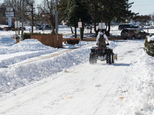 A man on an all-terrain vehicle makes his way down