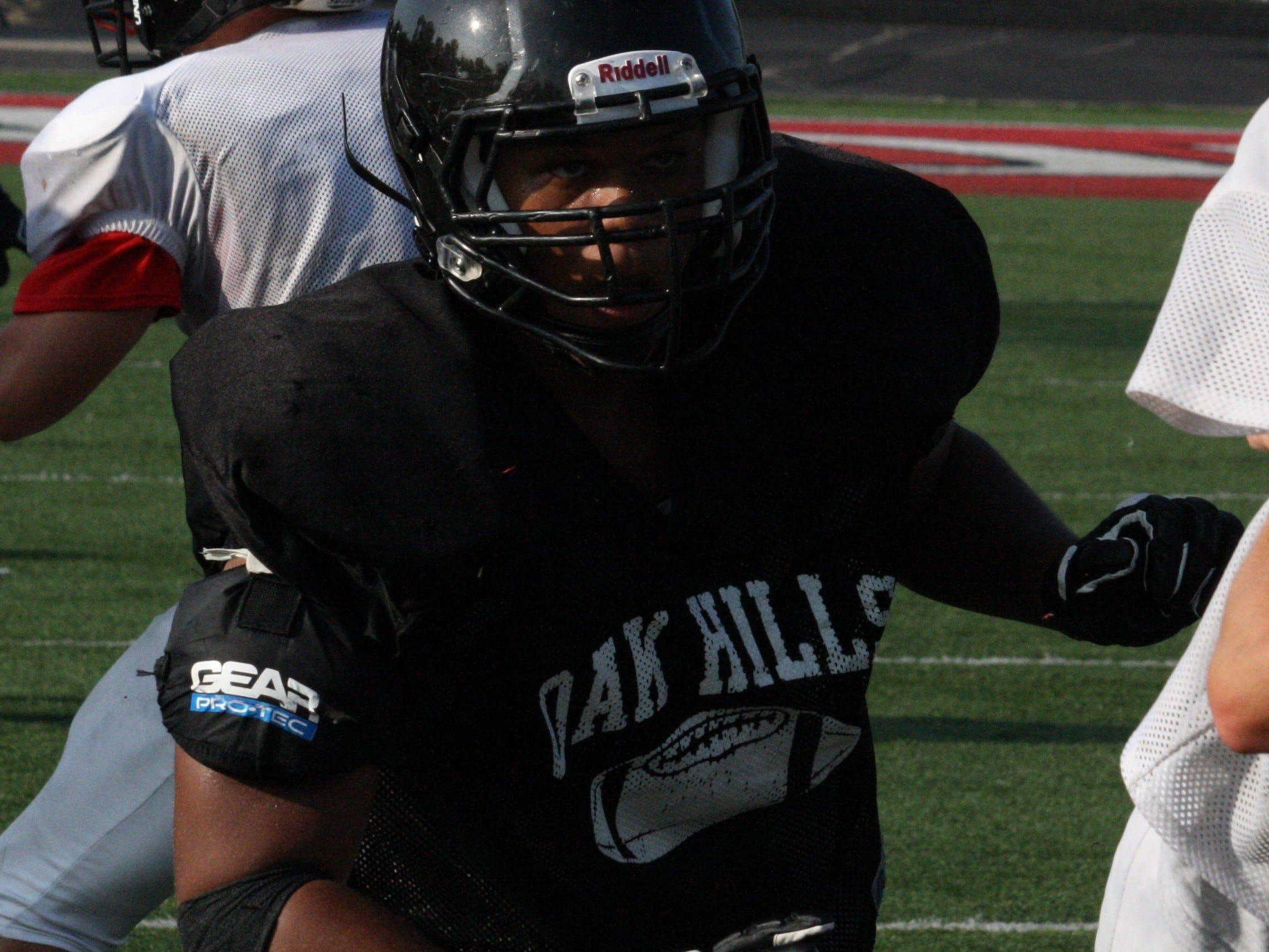 Oak Hills High School senior defensive lineman Montell Brown rushes the passer during practice Aug. 20 at Oak Hills. Brown led the team with seven sacks last season.
