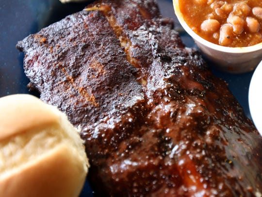 Ribs, half wet and half dry, with slaw and beans are