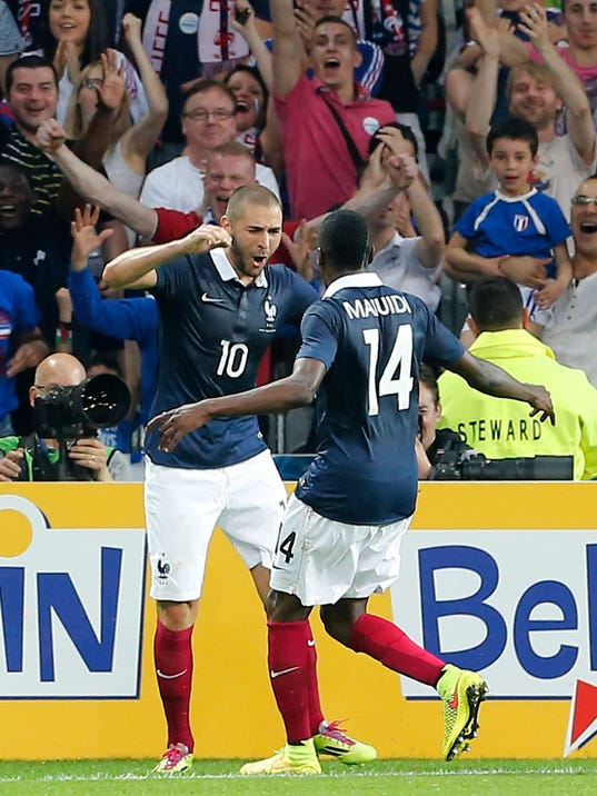 French soccer Karim Benzema, left, reacts after scoring against Jamaica with Blaise Matuidi during the friendly soccer match between France and Jamaica at the Lille Metropole stadium, in Villeneuve d'Ascq, northern France, Sunday, June 8, 2014.  France in preparation for the upcoming FIFA soccer World Cup in Brazil starting on 12 June. (AP Photo/Jacques Brinon)