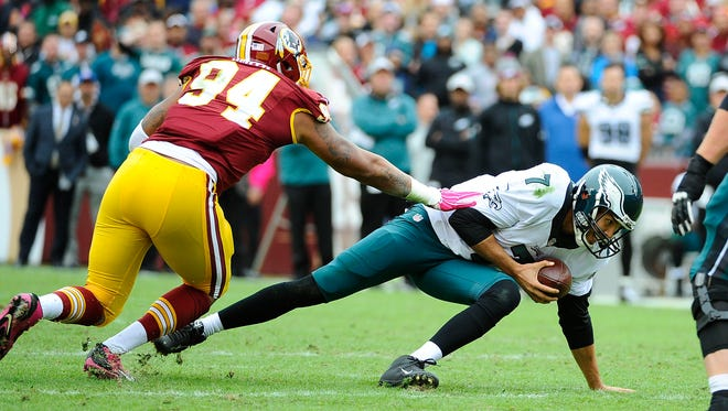 Oct 4, 2015; Landover, MD, USA; Philadelphia Eagles quarterback Sam Bradford (7) is sacked by Washington Redskins linebacker Preston Smith (94) during the first half at FedEx Field. Mandatory Credit: Brad Mills-USA TODAY Sports