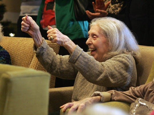 Ruth Goldstein cheers on a visiting dance troupe, one of the many events scheduled for the residents of Atria Hillcrest during the holiday season.