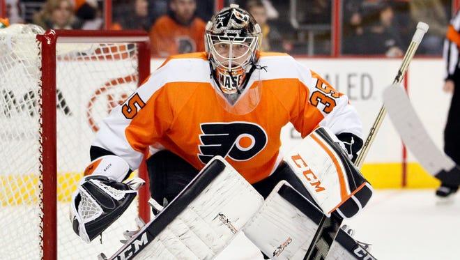 In this Jan. 18, 2014 file photo, Philadelphia Flyers goalie Steve Mason faces the Islanders in Philadelphia.