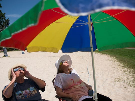 Rebecca, left, and Patty Mansfield watch for the eclipse
