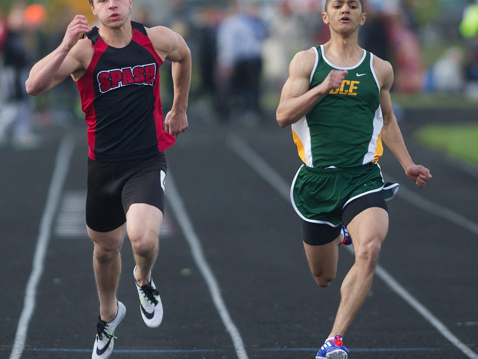 Stevens Point Area Senior High School's Victor Kizewski, left, and D.C. Everest's Deshawn Bryant, right, compete in the 100 meter dash the Wisconsin Valley Conference Track Meet at South Wood County Field in Wisconsin Rapids, Tuesday, May 19, 2015.
