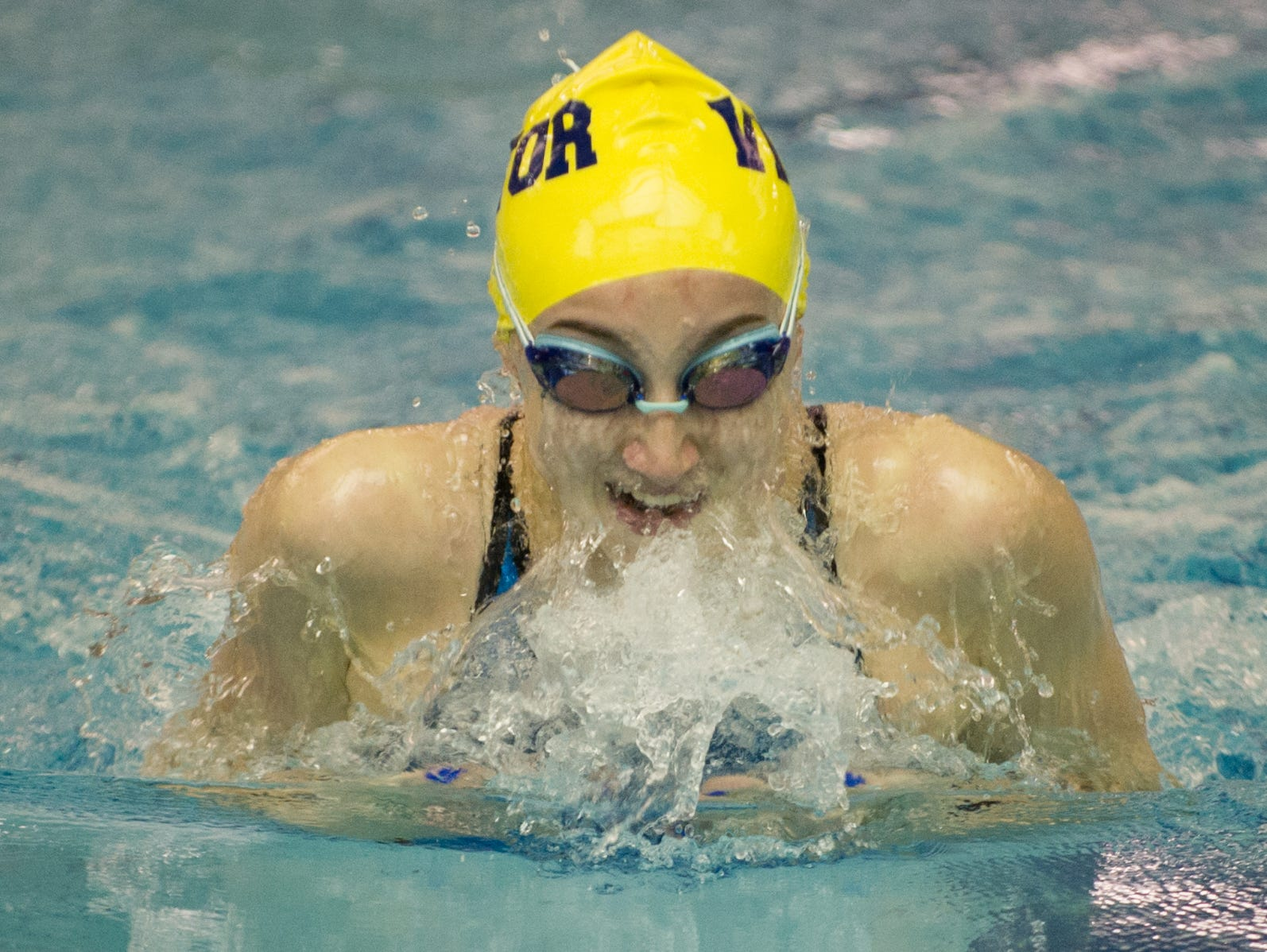 Victor's Mia Baggett swims the final of the 100-yard breaststroke.