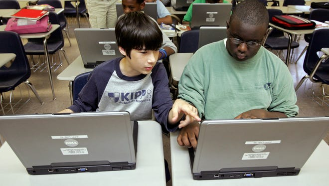 Seventh-grade students John Miller, left, and Fred Inmon work on laptops during a high school transition class at KIPP Academy. Two charter applications from KIPP Nashville that were denied in June have now been recommended for approval.