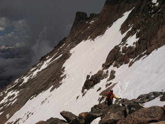 This photo from June 7 — two days before Matthew Burklow's fatal fall — shows the conditions of the Ledges section on the Keyhole Route on Longs Peak.  It's important to be prepared for all situations. 'The calendar may say it's June 16, but the conditions may be more like April 16,' Fort Collins resident Jim Davidson said.