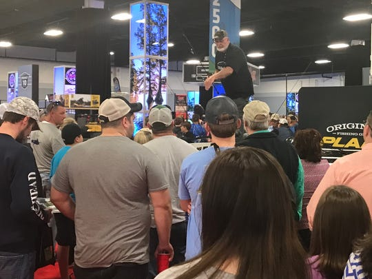 A pro fisherman teaches the finer points to a crowd at the Bassmaster expo