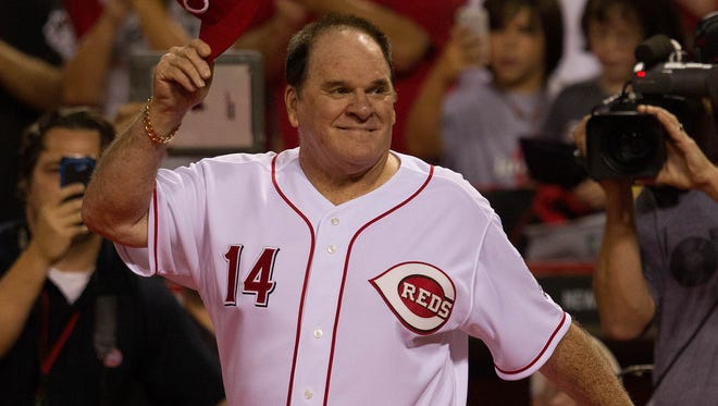 Pete Rose of the Big Red Machine takes the field after the Reds 3-2 win over the Los Angeles Dodgers  at Great American Ball Park.