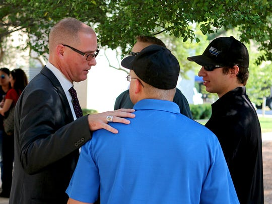 In this file photo, Robert Woodruff (left) talks with a group of people after announcing his candidacy for Justice of the Peace Precinct 1 Place 2 Friday morning on the steps of the Wichita County Courthouse.