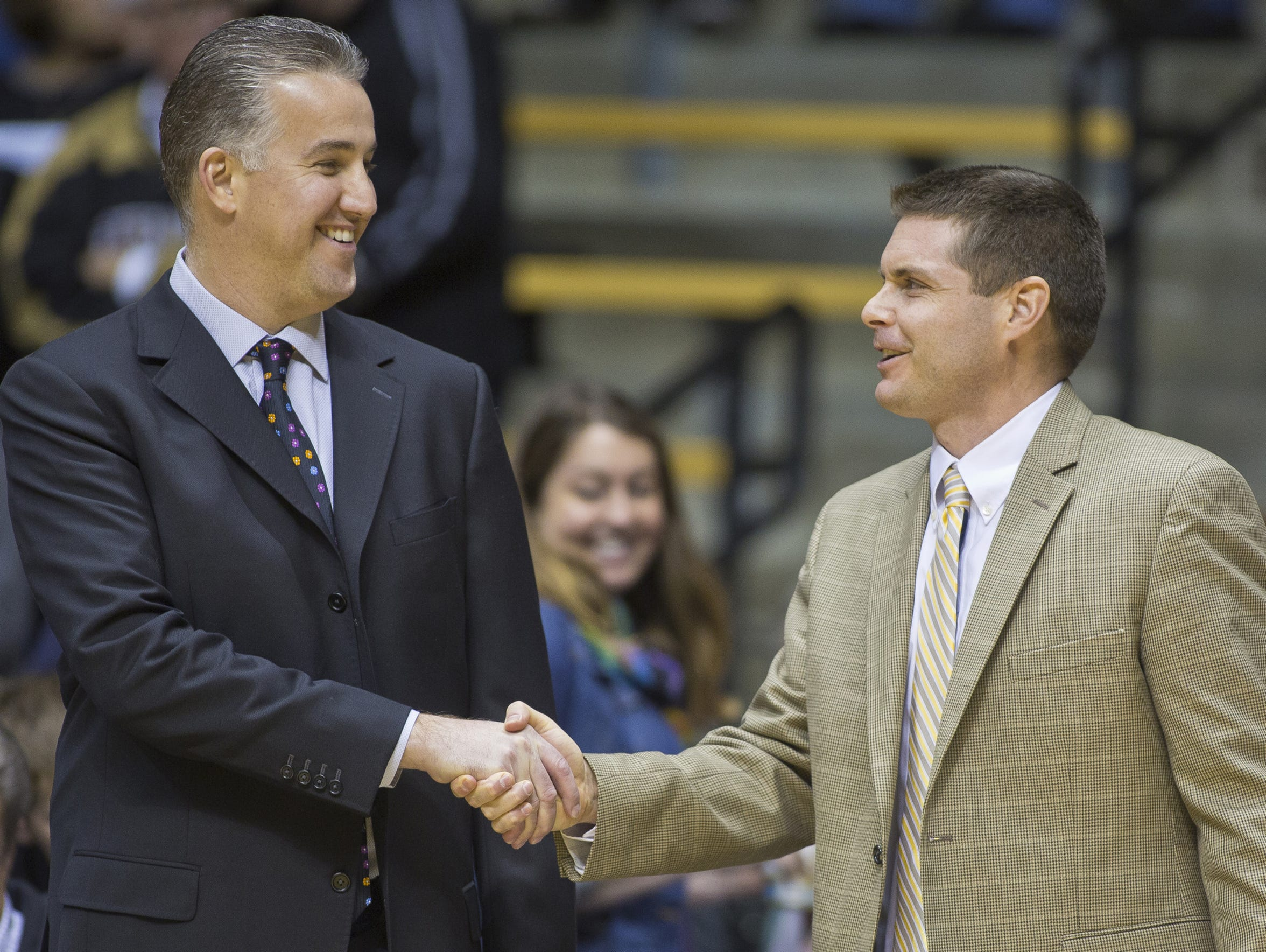 Purdue coach Matt Painter shakes hands with Purdue