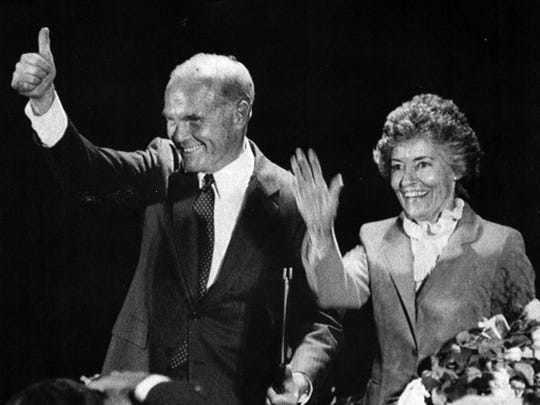 Ohio Sen. John Glenn signals thumbs up to supporters who heard him Thursday declared himself a candidate for president in New Concord, Ohio. At right is his wife, Annie Glenn.