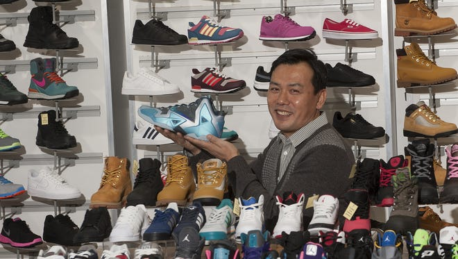 Kicks USA owner and president John Lee poses for a photo at his store in Cherry Hill in 2013.