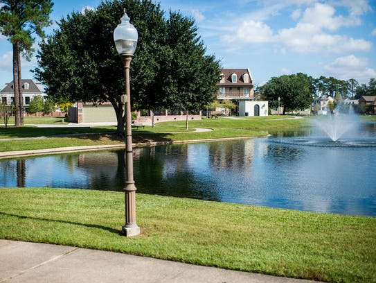 A walking path around a pond in River Ranch in Lafayette,