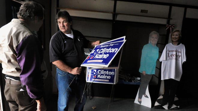 Mike Bullard, the chair of the Brown County Democratic Party, cleaned out out the party headquarters Wednesday Nov. 9, 2016 after Hillary Clinton's presidential loss to Donald Trump during the election the day before. As Bullard was loading items into his pickup, a visitor came by  asking for signs to keep as a souvenir of the 2016 election.  The man left with a small stack of them tucked under an arm.