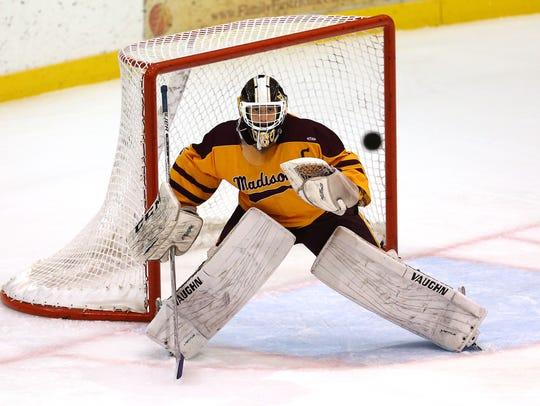 Madison goalie Matt Ubertaccio stares down the puck