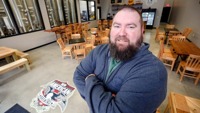 David Bryan, owner of New American Brewing stands for a portrait in his Ankeny taproom which opens today, Tuesday, Jan. 17, 2017.