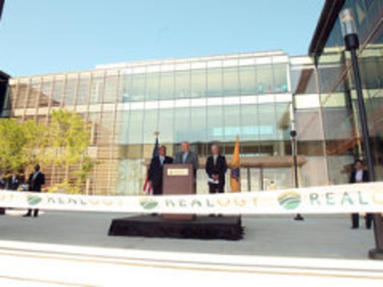 New Jersey Press Media file photo: Gov. Christie at a ribbon-cutting ceremony.