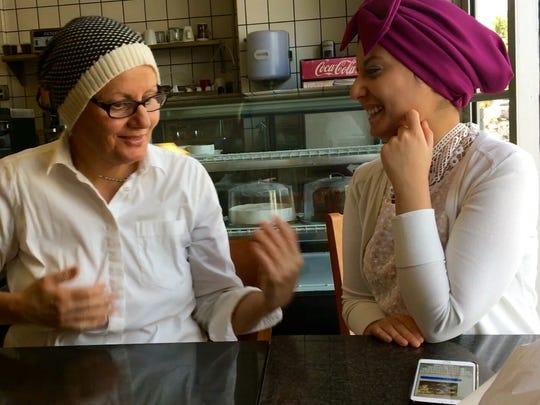 Asma'a Hussein, right, owns Opa! Mediterranean Gourmet