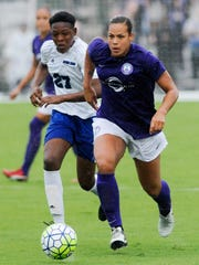Toni Pressley of the Orlando Pride is pursued by Nicole Broderick of Eastern Florida State College during an exhibition game in Melbourne.