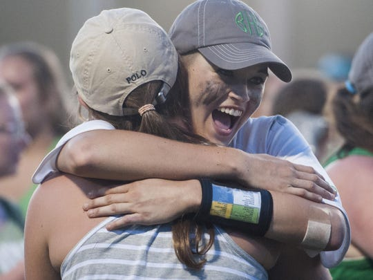Brantley's Alex Wilcox is hugged after being named the MVP at the AHSAA State Softball Tournament at Lagoon Park in Montgomery, Ala., on Thursday May 19, 2016.
