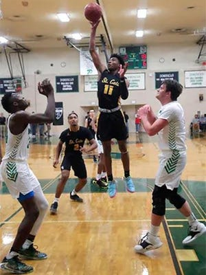 Tyrese Hunter hits a floater during a high school game in January 2020. Hunter committed Tuesday to Iowa State, choosing the Cyclones over scholarship offers from several high-major programs.