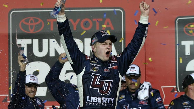 William Byron, driver of the No. 9 Liberty University Toyota, celebrates a Truck Series win at Kansas Speedway on May 6.