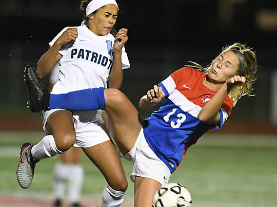 Freehold Twp Jada Colbert battles Wall's Jamie Iorio.Girls Soccer: Shore Conference Final, Wall vs. Freehold Twp on 10/26/2017 )Larry Murphy | for the Asbury Park Press)