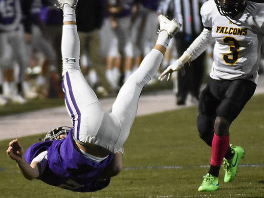 Rumson - Fair Haven's Dan Harby goes down after going for a 1st down vs. Monmouth regional.   Football: Monmouth Regional at Rumson -  Fair Haven on 10/27/2017  (Larry Murphy | for the Asbury Park Press)