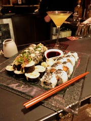Sushi: Front left: Firecracker Roll; front right: Sesame Salmon Roll and in back is a Fried Umami Roll as seen Thursday January 21, 2016 at The American Club in Kohler during their sushi night.