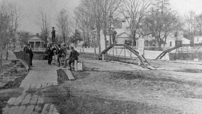 The Chenango Canal at Lewis Street, around 1865.