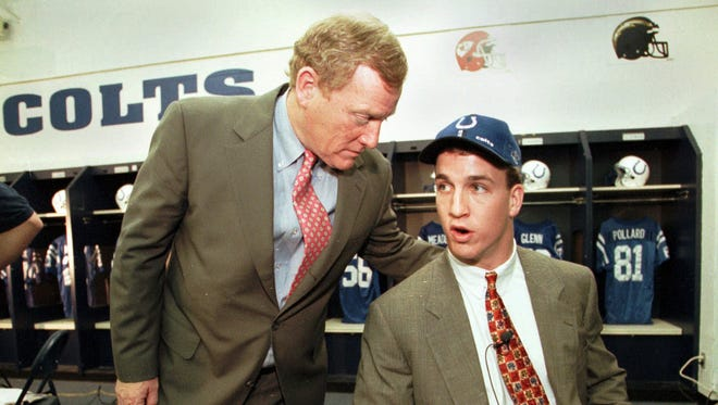 In this file photo, Peyton Manning, right, the No. 1 pick in the NFL draft, talks with Indianapolis Colts president Bill Polian, left, in the team's locker room in Indianapolis, Saturday, April 18, 1998.