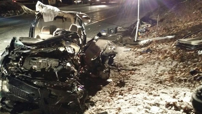 Toyota sedan after it struck the rear of a state Department of Transportation plow on Route 9W in Congers Monday. The image of the Toyota is seen here after emergency workers used electronic tools to cut open the car and extricated the man who was driving.